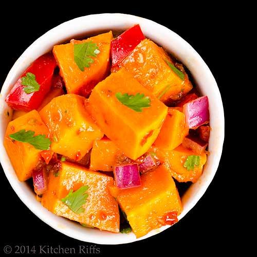 Chipotle Sweet-Potato Salad in ramekin, overhead view on black
