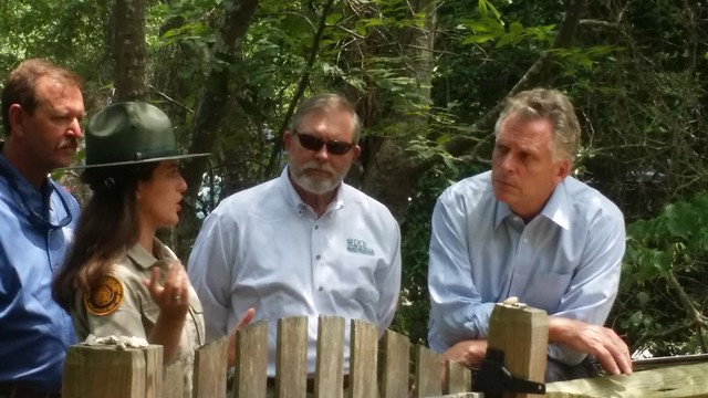 Governor McAuliffe pays his respects at the Virginia Indian burial mound.