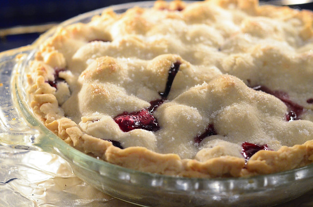The pie filling starts the bubble through the crust of the pie.