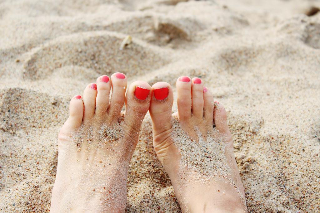 toe manicure, pink nail polish