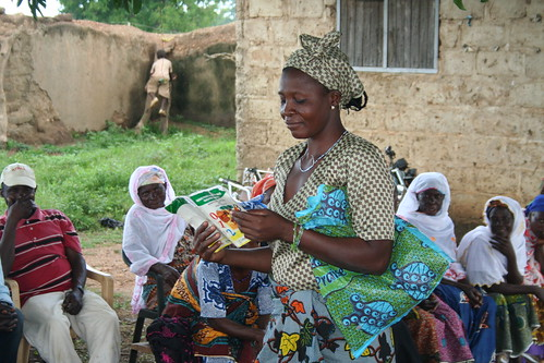 A woman reads from a booklet during a group training.