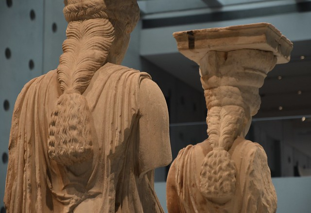 Caryatids from the Erechtheion on the Acropolis, her hair is braided and falls in a thick rope down her back, Acropolis Museum, Athens