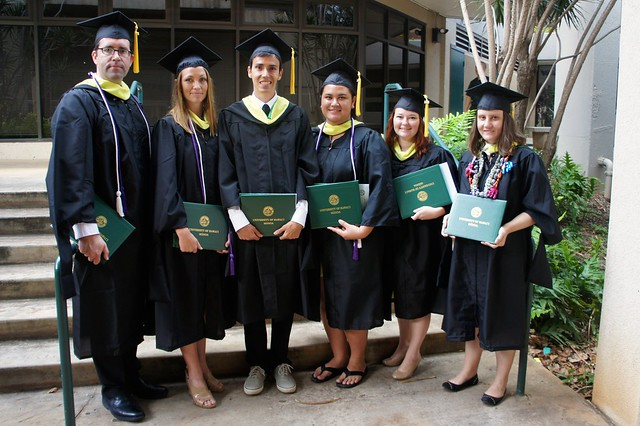 <p>2014 spring graduates showing off their University of Hawaii at Manoa master's of library and information science (MLISc) degree. Photo by Andrew Wertheimer.</p>