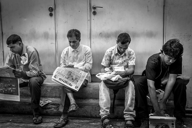 Four men minding their own business.