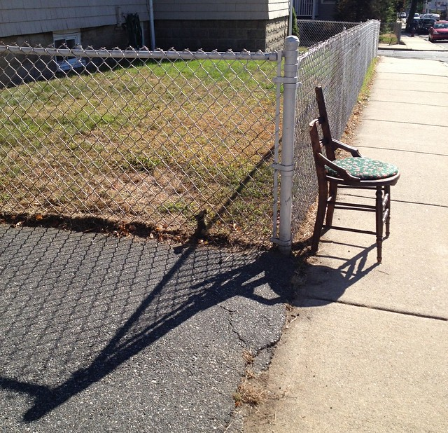 Broken Chair Casts Long Shadow