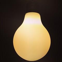 decor(0.0), flameless candle(0.0), lamp(0.0), lampshade(0.0), sconce(0.0), incandescent light bulb(1.0), light fixture(1.0), yellow(1.0), light(1.0), lighting(1.0),