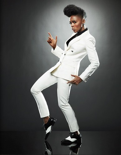 Janelle Monae as Cindy Mayweather in a white suit.