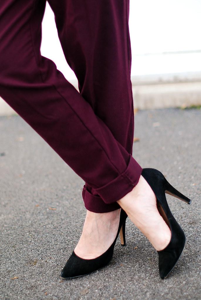 Purple peg legs and black pointed heels