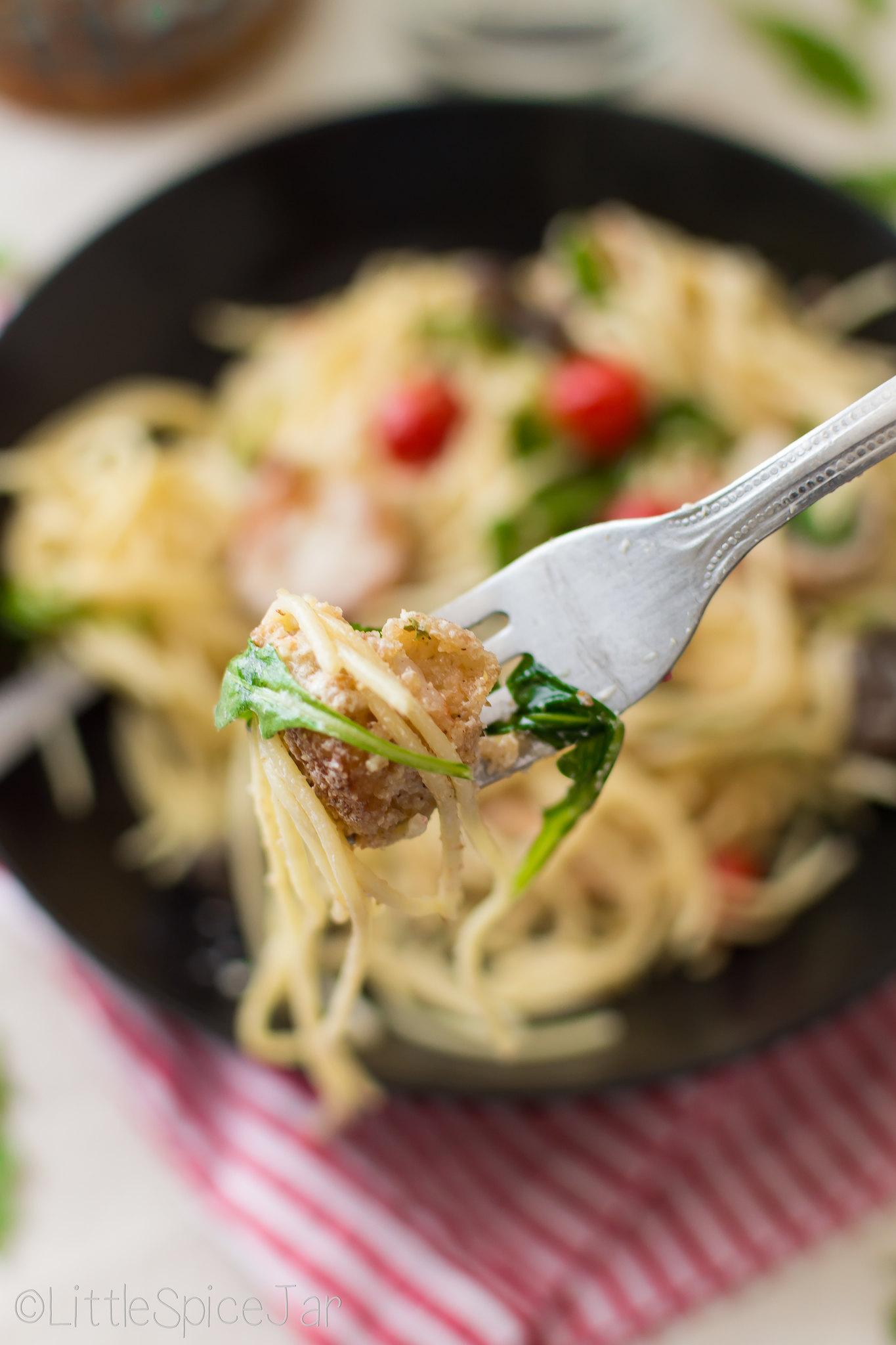 shrimp pasta and arugula on fork