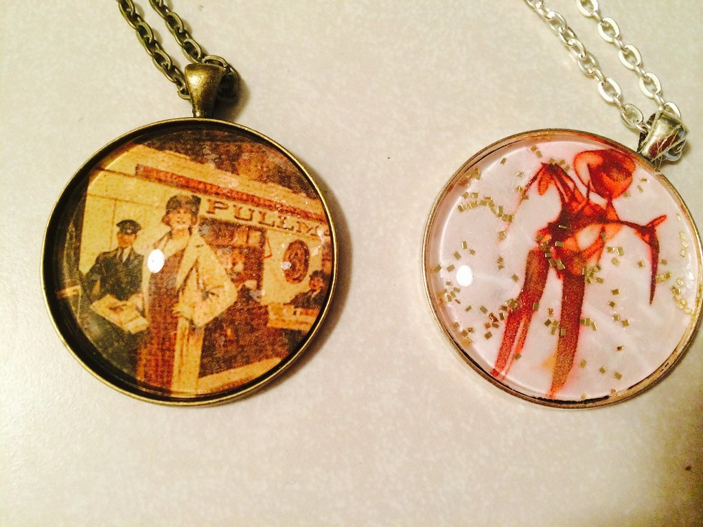 Two photo pendant necklaces.