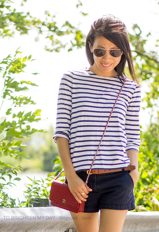 striped top, navy shorts, red crossbody bag