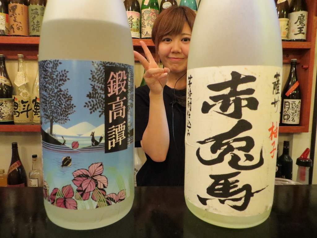 Two full-flavored shochu bottles and a friendly bartender