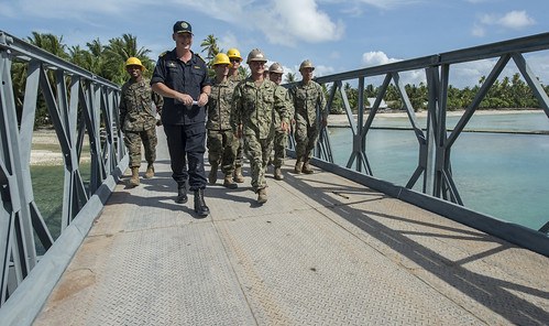 Royal New Zealand Capt. Tony Millar, Pacific Partnership 2013 deputy mission commander, walks alongside engineers