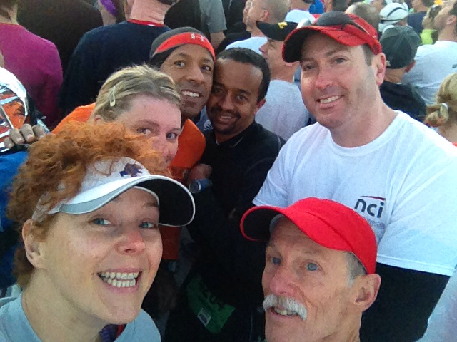 Huddling in the chilly breeze at the Army 10 Miler start
