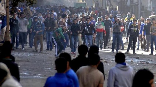 Egyptians clash with security forces in the southern Cairo district of Giza on Friday January 24, 2014. Nine people died in bombings and other unrest. by Pan-African News Wire File Photos