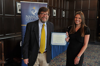 Director A. James McAdams presents Marielle Hampe with the 2014 Wegs Prize for best capstone essay.