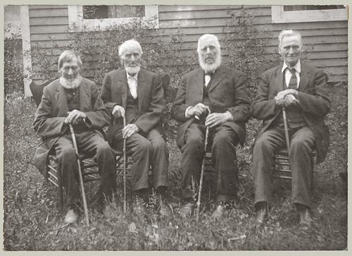 Four men with canes