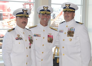Vice Adm. Charles W. Ray, commander of Coast Guard Pacific Area, stands with Capt. Charles G. Alcock (left), former commanding officer of Coast Guard Cutter Steadfast, and Cmdr. John R. Bitterman, commanding officer of Coast Guard Cutter Steadfast, during a change-of-command ceremony at Seattle's Museum of History and Industry, after Bitterman assumed command from Alcock, July 15, 2014. Bitterman's previous assignment was as the Coast Guard Police Attache in Bogota, Colombia. U.S. Coast Guard photo by Petty Officer 2nd Class George Degener.
