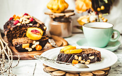 piece of chocolate cake with pumpkin, nuts and fre…