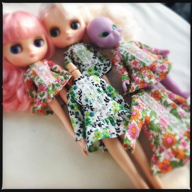 Five dresses waiting for embellishment.