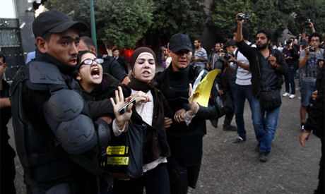 Egyptian protesters being detained by the police. Women have been arrested and sentenced to prison. by Pan-African News Wire File Photos