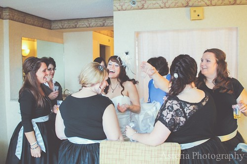 Bride celebrating with bridesmaids before wedding