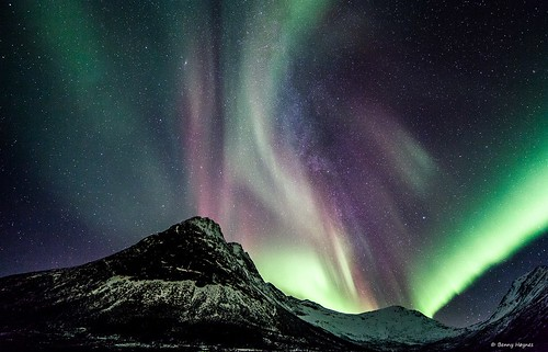Dec 12 2012 Some aurora outburst over hills, the milkyway in middle of aurora, from Godfjord, Sortland, Norway
