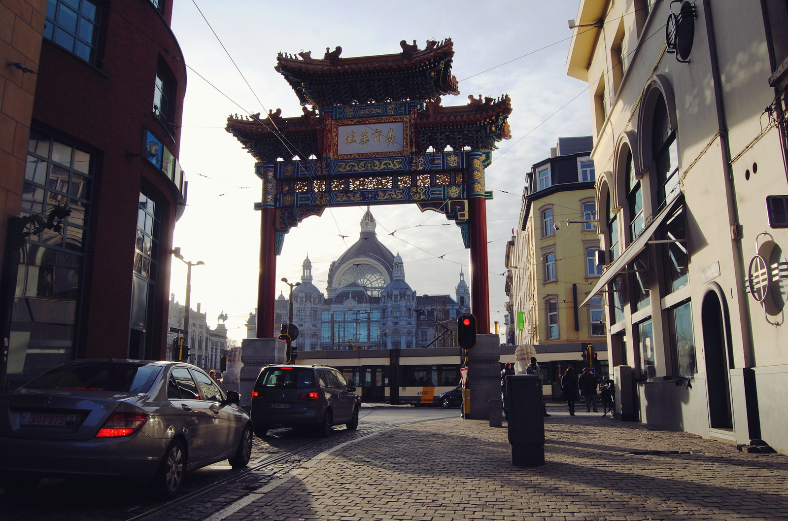 Things to do in Antwerp: a view of the Chinatown gate and the central station.