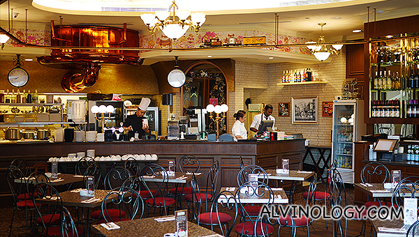 Inside the Au Chocolat bistro: Can you spot the toy steam engine train running on suspended railway tracks?