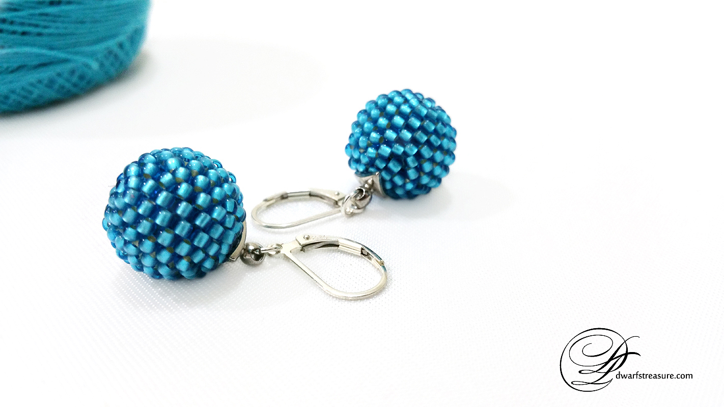 Stylish blue beaded ball earring