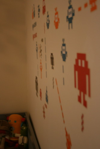 Space Invaders wall decals over crib (from Ikea)