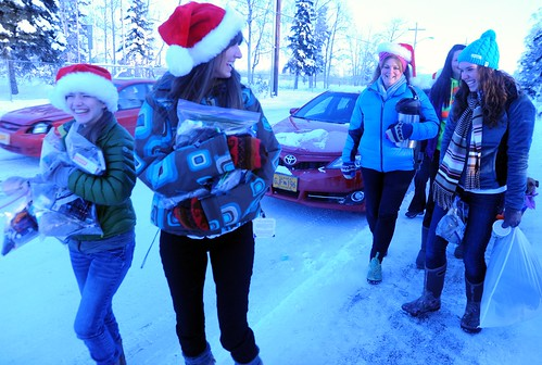 Pretty playful Santas, community volunteers out to spred Christmas joy to the world - distributing hot cider, cookies, candy, and other goodies, on a cold day with snow, Rosie is behind them all the way, Anchorage, Alaska, USA by Wonderlane