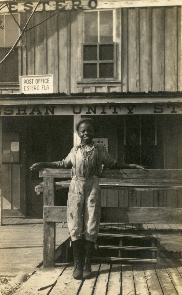 Unidentified young man in front of the Koreshan Unity general store on the Estero River