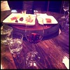 Celebratory wine with cheese & meat plate at Della Vita