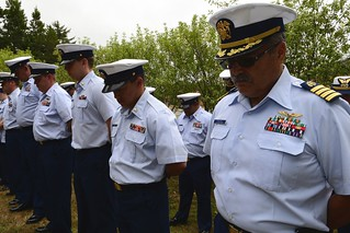 Coast Guard Sector Humboldt Bay crewmembers bow their heads during a memorial service, Friday, July 11, 2014 in Humboldt Bay, Calif. The crew honored the twentieth anniversary of the sacrifice of four Coast Guardsmen who perished in the line of duty while attempting to save the lives of others. U.S. Coast Guard photo by Petty Officer 3rd Class Loumania Stewart