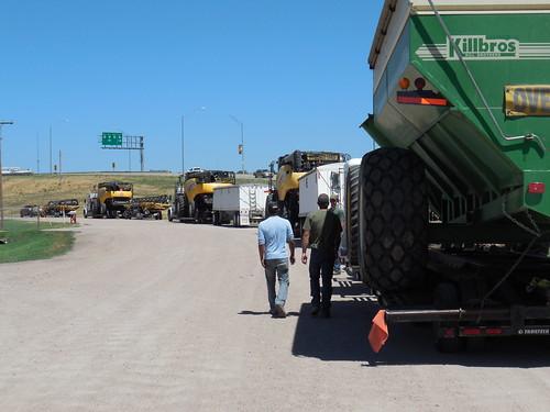 Jose, Kasey, and Brandon walk to their trucks