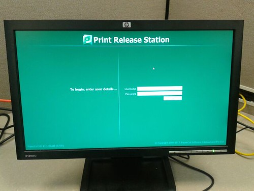 The print release station is a computer monitor between the printers.
