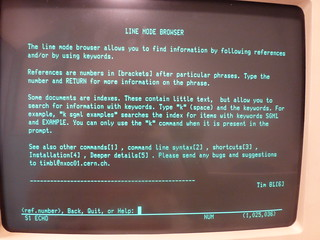 Photo of an old IBM computer running the line mode browser, with the explanation page displayed