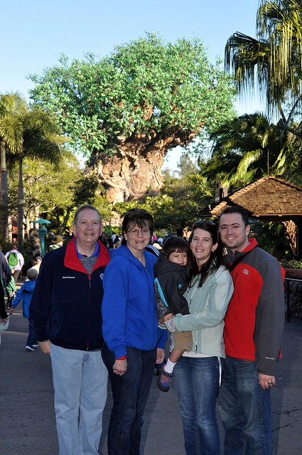 The family in front of the Lion King Tree of Life
