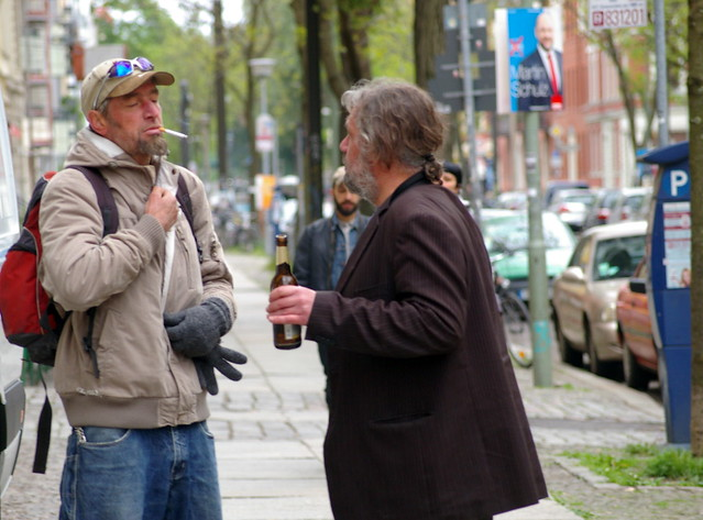 A Couple Of Blokes Having A Drink And A Chat In The Street