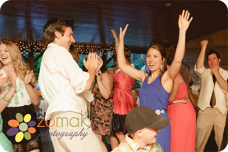 Candid shots of guests enjoying the music and dancing at Allison and Zach's wedding.