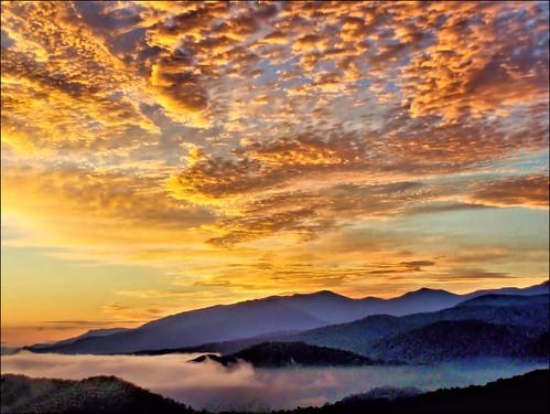 nature clouds sunrise tennessee earlymorning pointandshoot gatlinburg smokymountains autofocus mountaintops autoexposure corelpaintshoppro seviercountytennessee nikoncoolpixs01