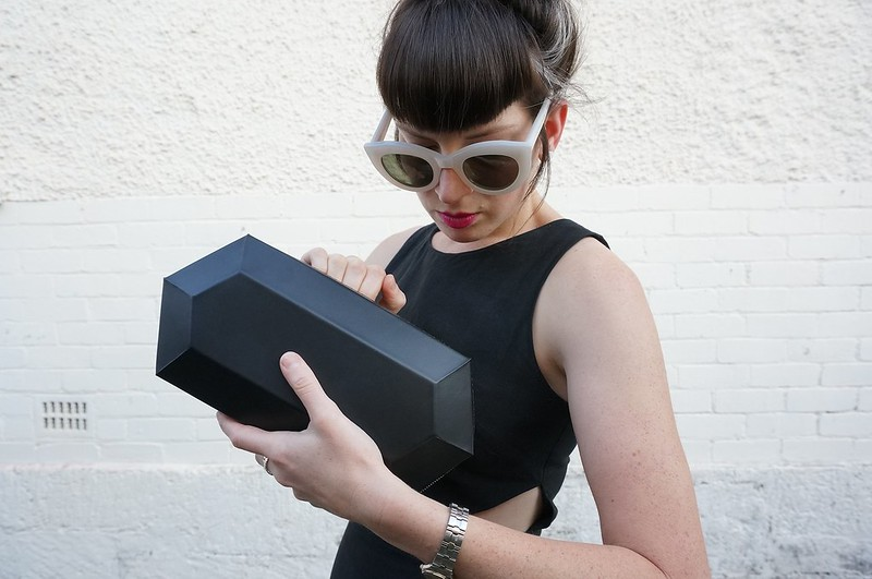 Alpha Cruxis geometric clutch outfit