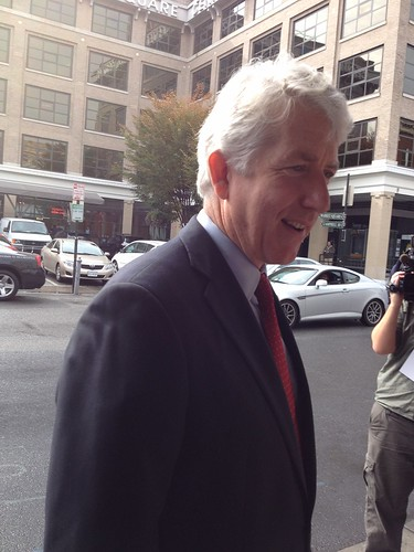 Mark Herring campaigns with the crowd waiting for Terry McAuliffe and President Clinton