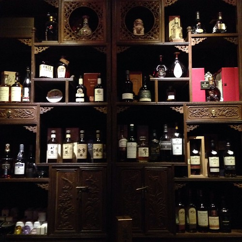 Rosewood cabinet used to display Whisky, Cognac and Bourbon.