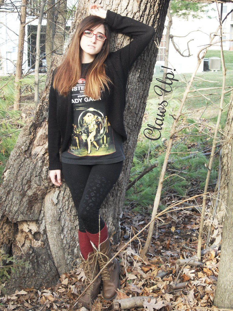 black sweater, Lady Gaga concert shirt, black leopard leggings, brown boots