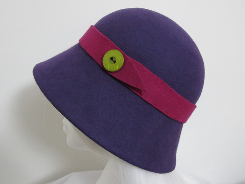 Purple felt cloche hat with pink felt band and lime green button