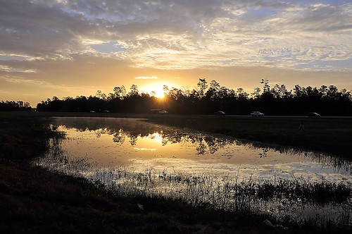 road blue sunset sky orange sun reflection nature water sunrise landscape pond texas reflect