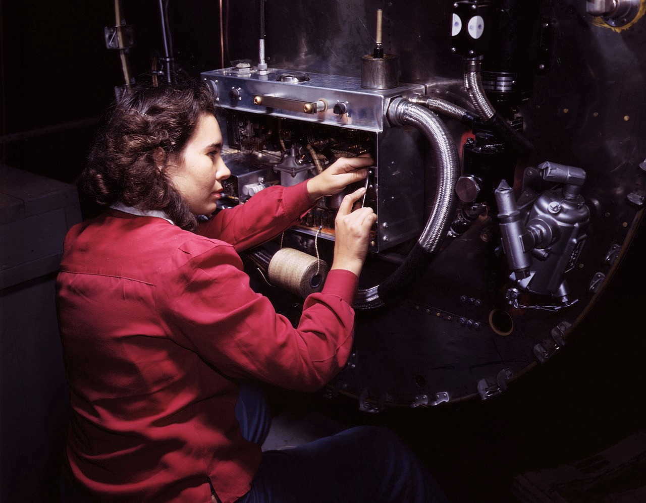 Switch boxes on the firewalls of B-25 bombers are assembled by women workers at North American Aviation, Inc's Inglewood, Calif, plant