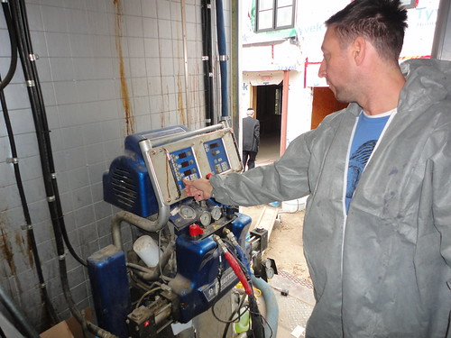 mixing spray foam components together on job site with Graco H-40 Plural Component Reactor
